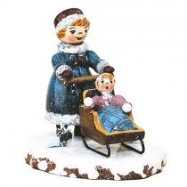 Winterkinder - Mädchen mit Kinderschlitten